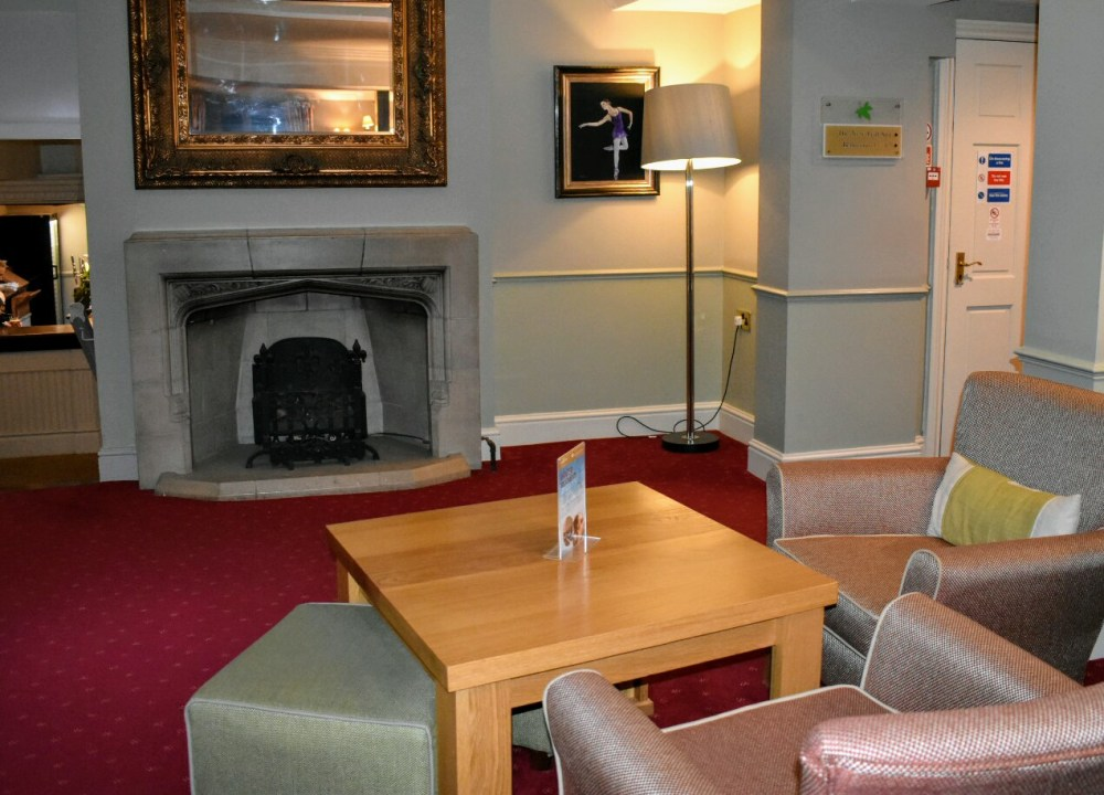 A comfy seating area and fireplace