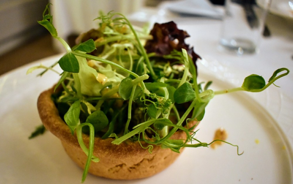 A quiche with salad leaves on top