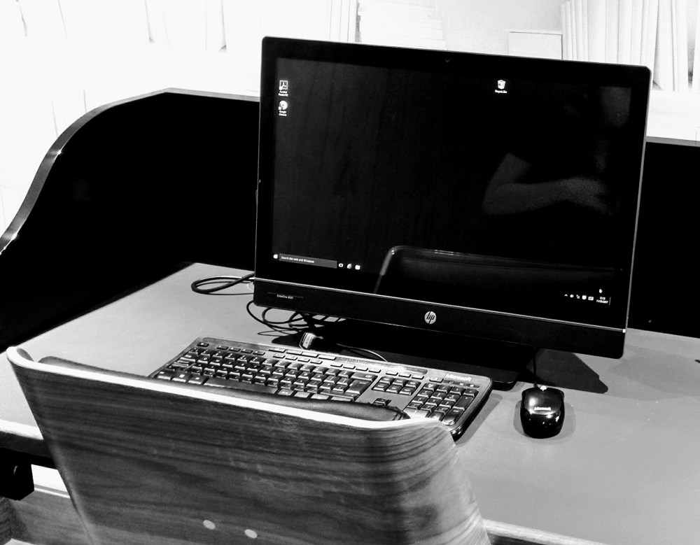 A black and white photo of a computer