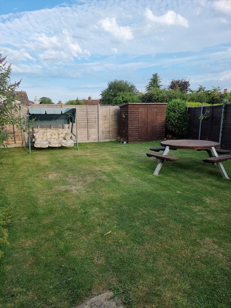 Back garden at Endeavour short breaks with sofa swing and picnic table