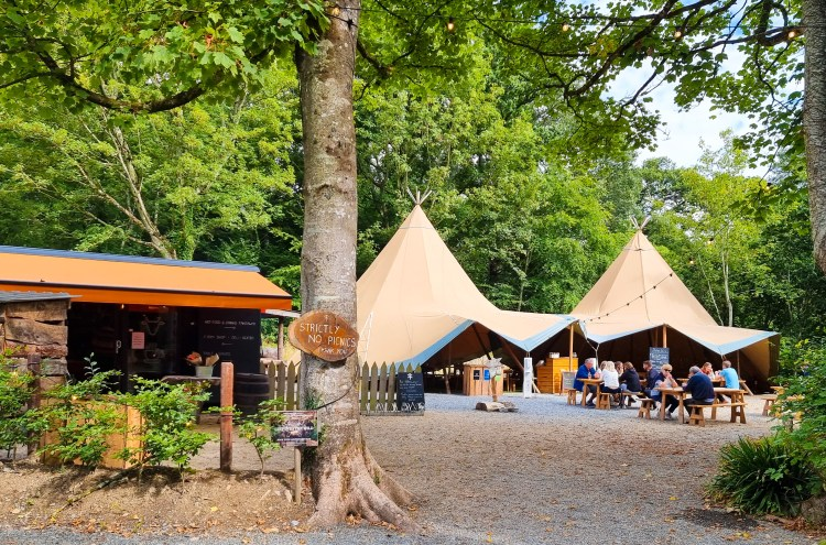 Fodder Cafe, Finnebrogue woods, Northern Ireland. A woodland tipi setting for an outdoor restaurant