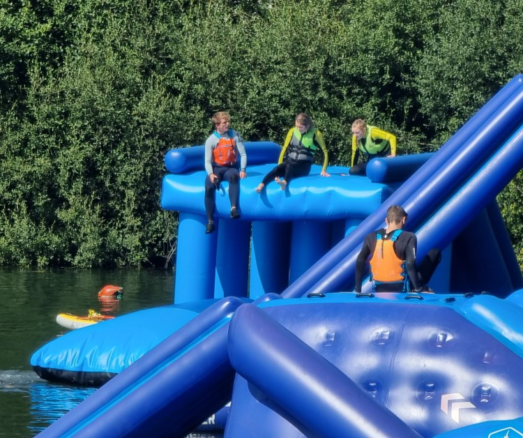 Wild shore Delamere - a water based adventure center with inflatable aqua park, aqua chimp, tubing, wakeboarding, swimming and paddle boarding.