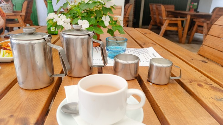 Cup of tea with two pots at the Hanging Gate pub in chapel-en-le-firth