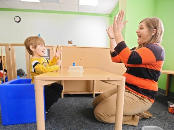 Please photograph one of the therapists at Kennedy Krieger Institute working with a child. The story is for the federal workplace pa