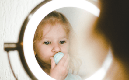 kid in front of mirror