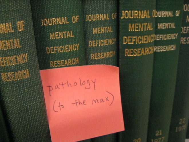 """Journal of Mental Deficiency Research [with a post-it that says """"pathology (to the max)]"""