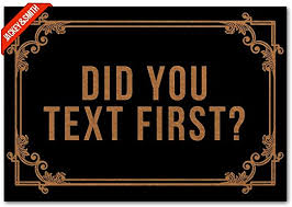 "Black doormat with brown writing that says ""Did You Text First?"""