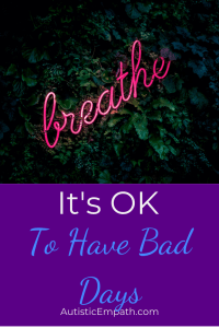 "Pink neon cursive sign reading ""breathe"" among dark green leaves. White and blue text on a purple background reads: ""It's OK to Have Bad Days"""
