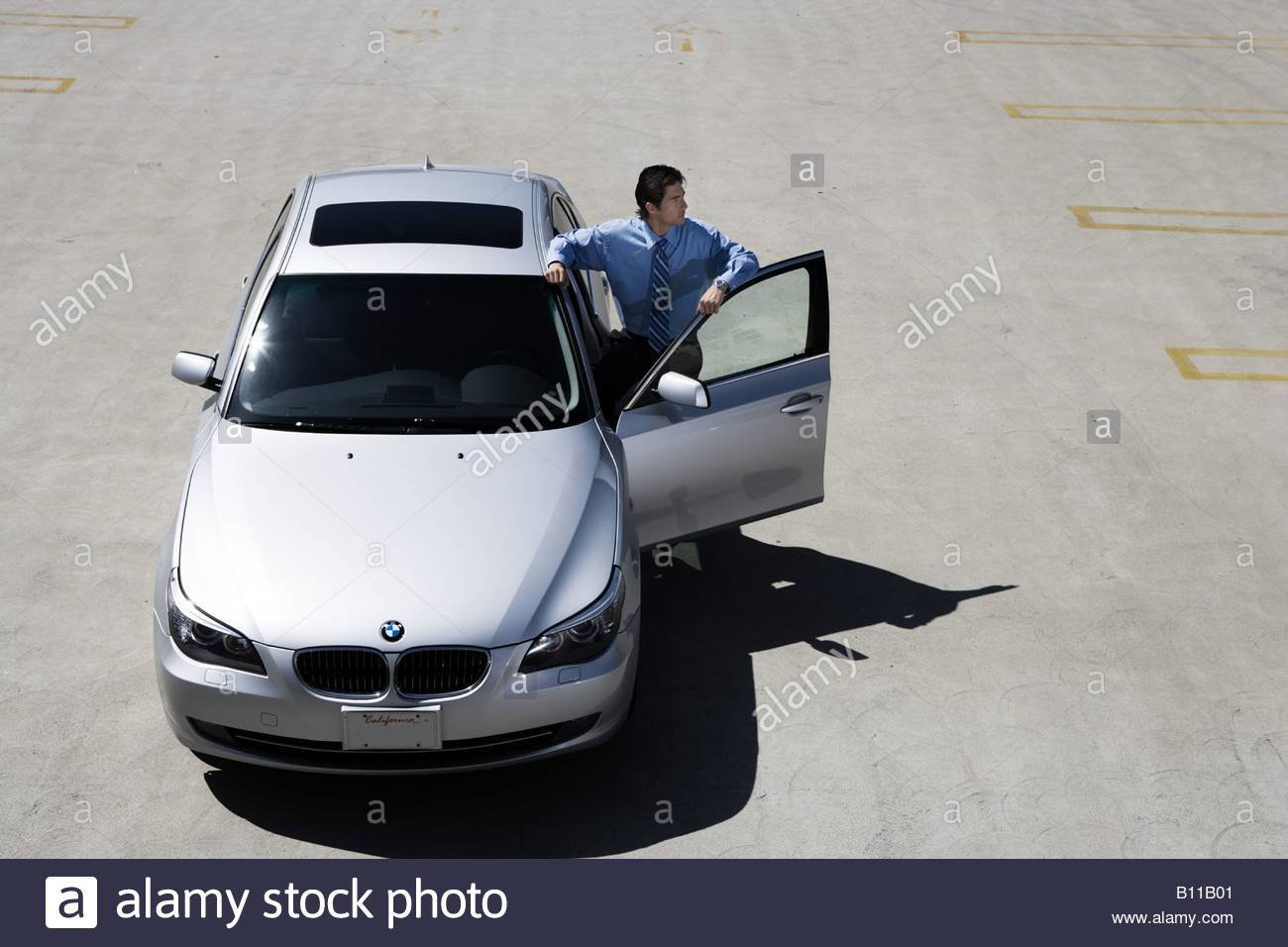Latest Asian Man Stands By Open Door Of His Bmw 5 Series Car Free Download