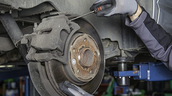 Squealing brakes being replaced in auto repair shop