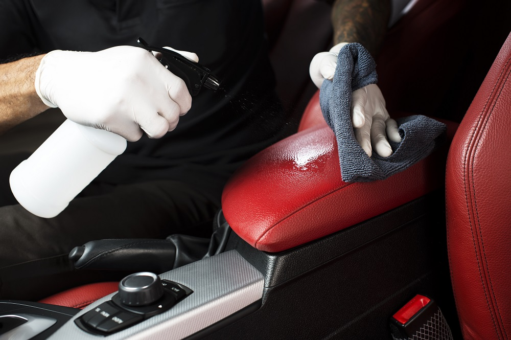Cleaning car interior.
