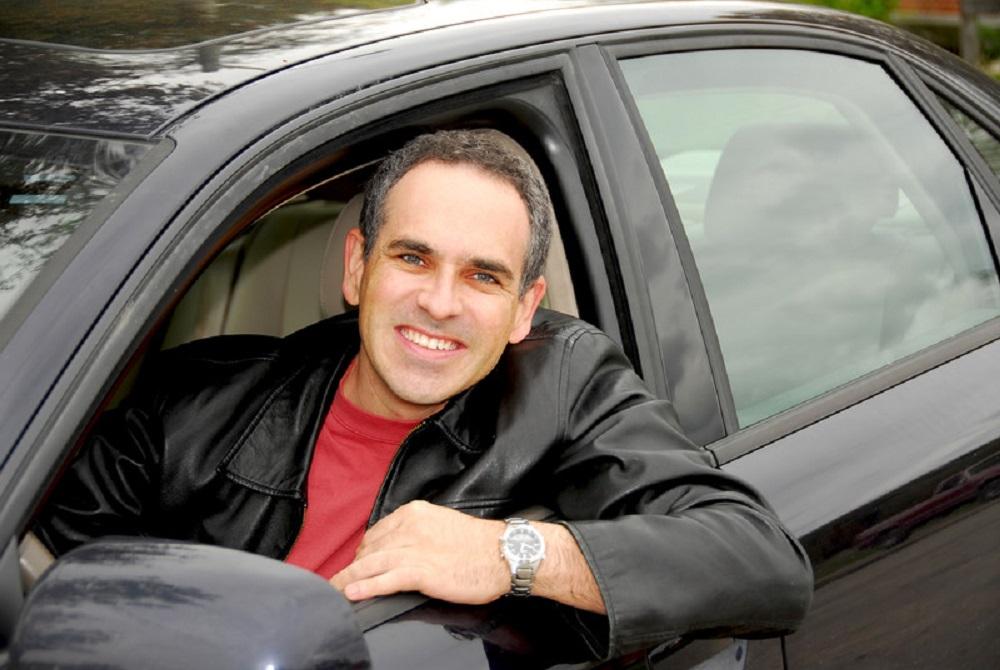 man in black car