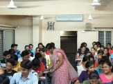 Science techer explaining to the students