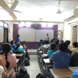 X Std student giving the science seminar in presence of their teacher (2)