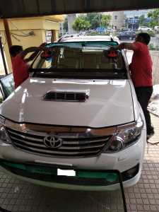 cashless fortuner windshield replacement