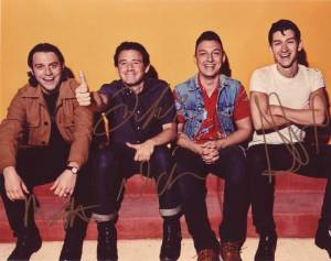 Arctic Monkeys in-person autographed band photo by all 4