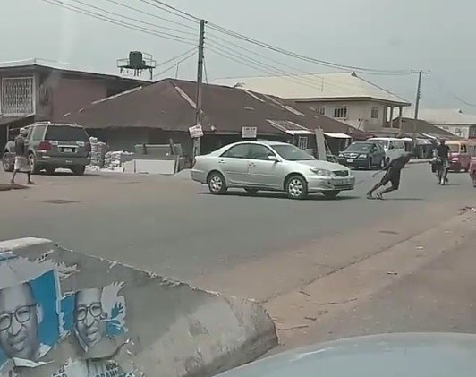 man towing car with rope