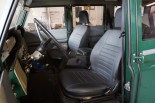 Defender Bucket seats and custom carpeting / insulation.