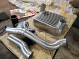 Fabricated Charge-Air pipes and up-rated intercooler made in-house to fit this application.
