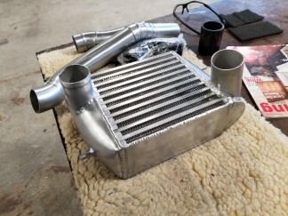 We used a much thicker and more efficient bar & plate intercooler core for more power!
