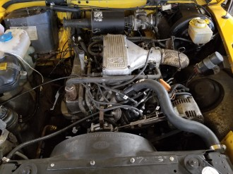 Engine reassembled : new belts / hoses, tune-up parts, water pump, themostat and more.