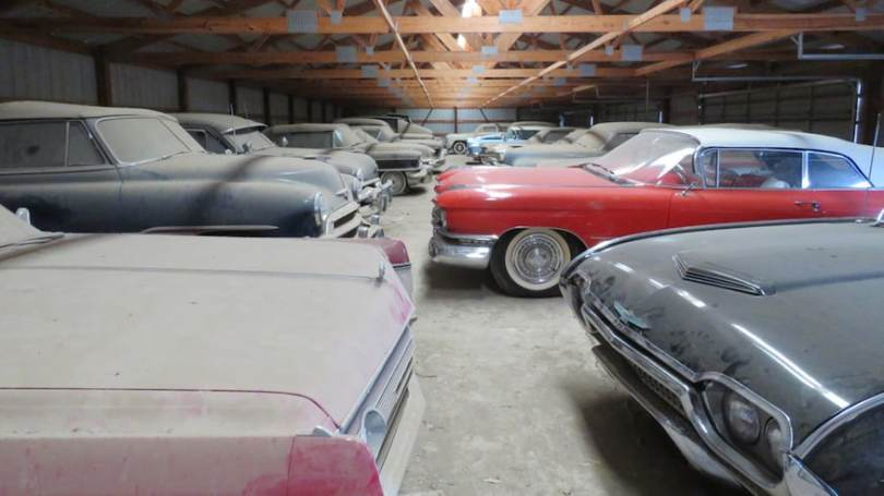Rows-of-Dusty-Collector-Cars-Lined-up-in-a-Barm