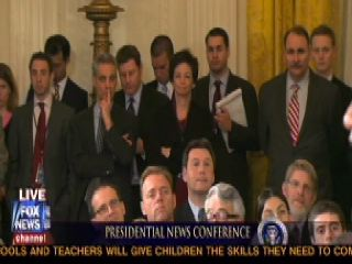 Rahm Emanuel and David Axelrod giving Obama hand signals