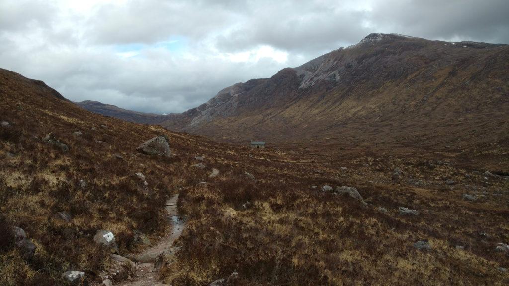Coire Fionnaraich Bothy, dwarfed by Glen Carron.