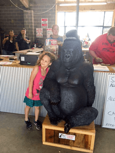 Little girl with King of Parts Gorilla