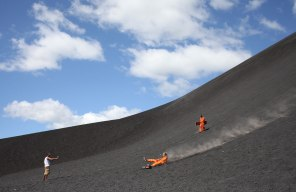 A guide uses a speed gun to ducument how fast boarders make it down Cerro Negro. Big Foot Hostel runs the only tour with a speed gun. Photo: Alex Washburn