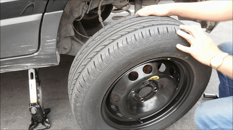 Image result for changing flat tire