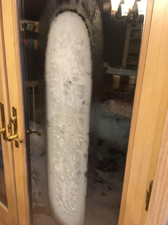 Sheet Of Ice Formed Between The Glass Panes Of This Door