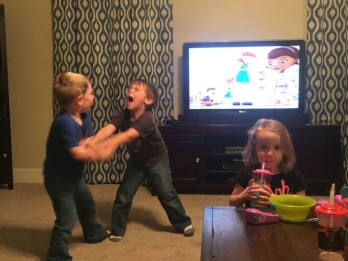 boys fight girl laughing