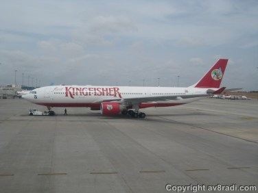 A new Kingfisher (at least back in 2009) Airbus A330 taxing to the stand beside us