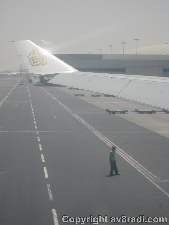 Pushback…Note the Flight dispatcher and that the Terminal 3…due to open in 2 months is still dirty