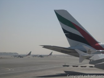 A company Airbus A330-200 and a Boeing 777 holding short of the runway