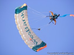 The skydivers as he swoops over the viewing area