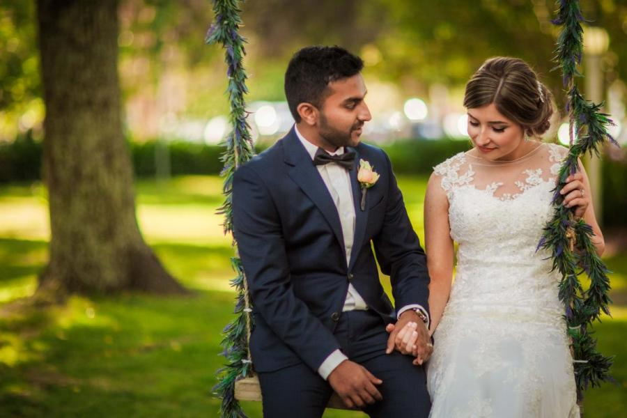 bride and groom on swing at Linley Estate reception venue Melbourne