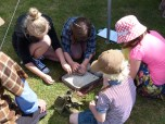 Grinding wheat to make flour on a flat quern