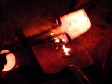 Pouring the molten tin.