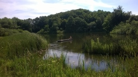 Boating across the Stone Age lake.
