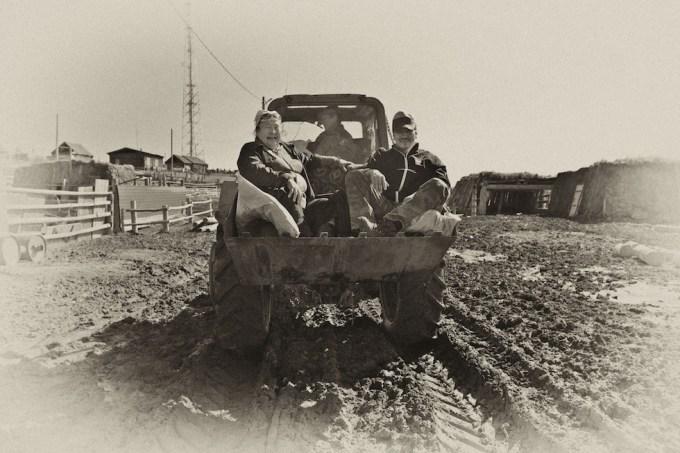 In the tractor's scoop across Siberia. Photo © Galya Morrell