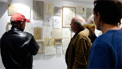 Bertyl Lernoud et Flèchemuller regardent dessins