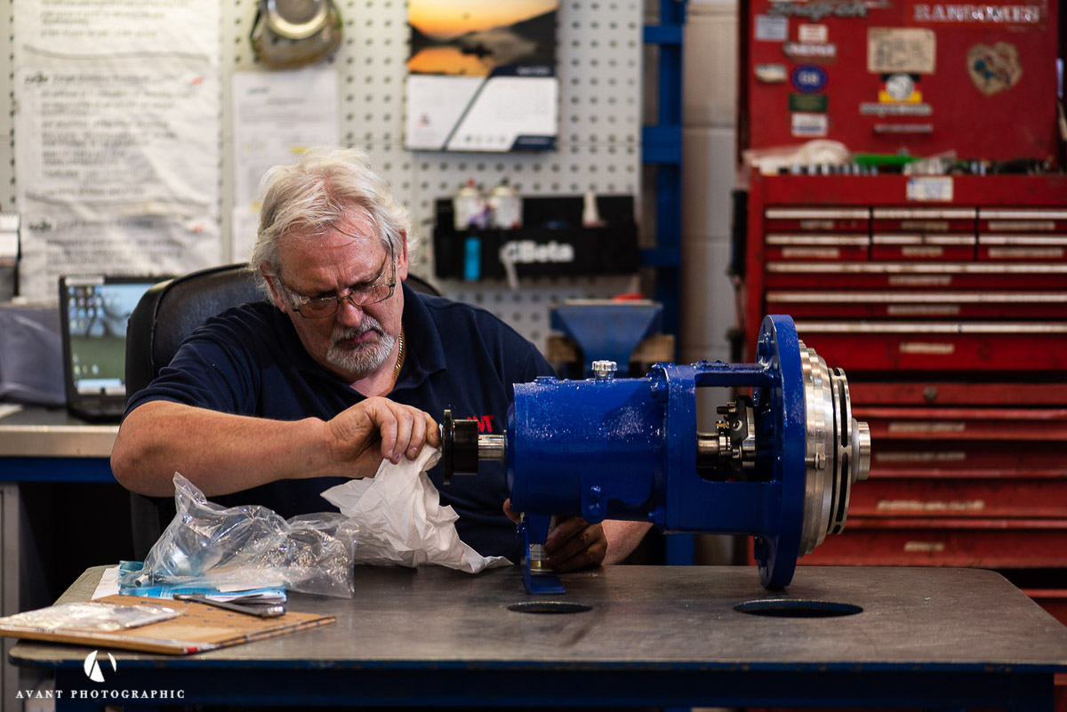 Avant Commercial photographer Phil Burrowes Day in the life photoshootEngineer checks pump before despatch to client