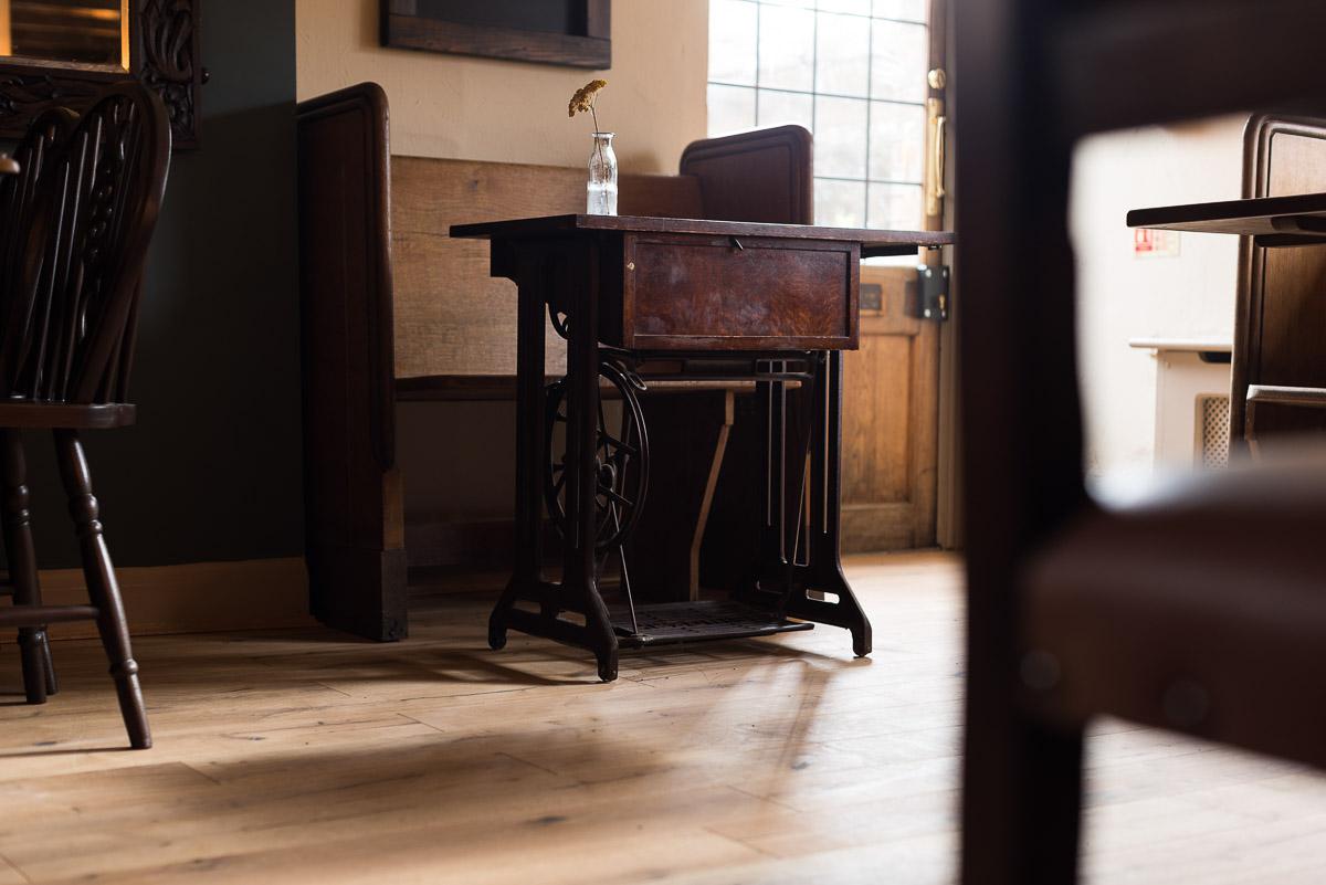 Retro scool desk and church pew in Rainbow pub