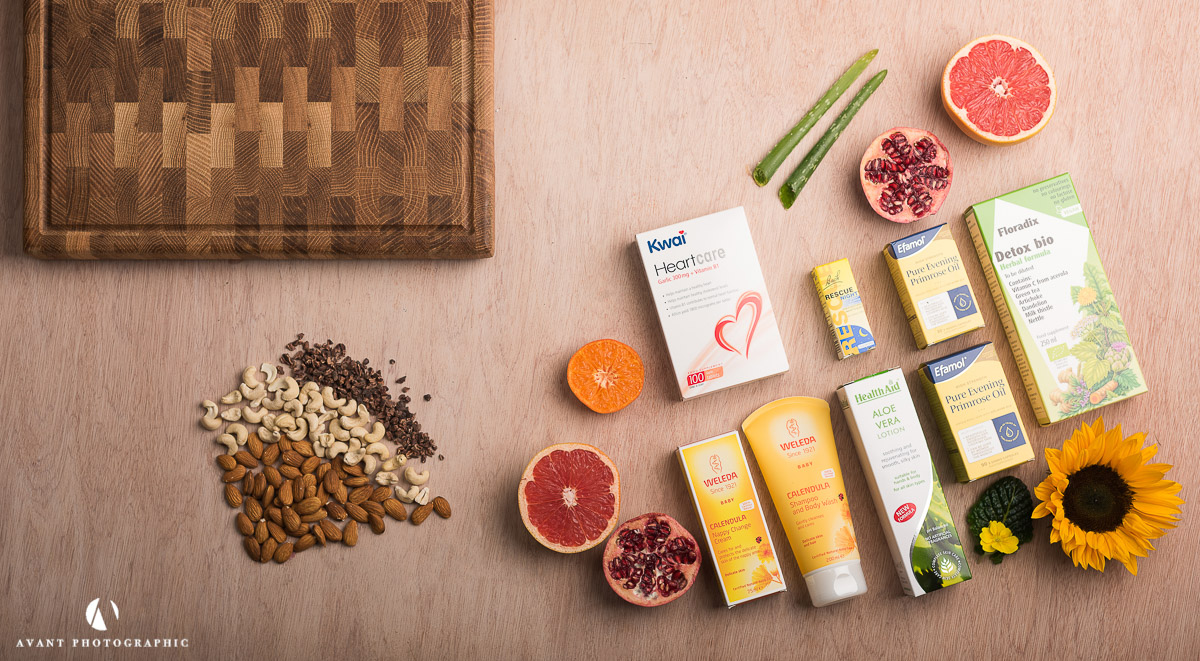 Flat lay on light background of health products with natural ingredients
