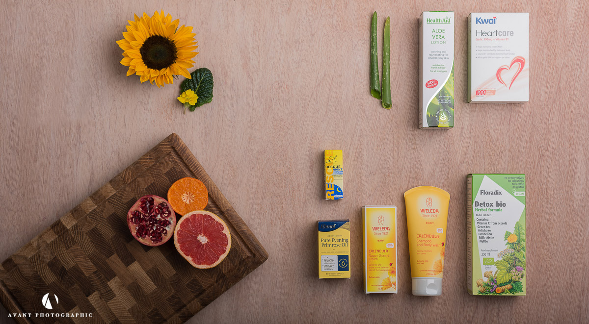 Flat lay of health products with natural ingredients on light background
