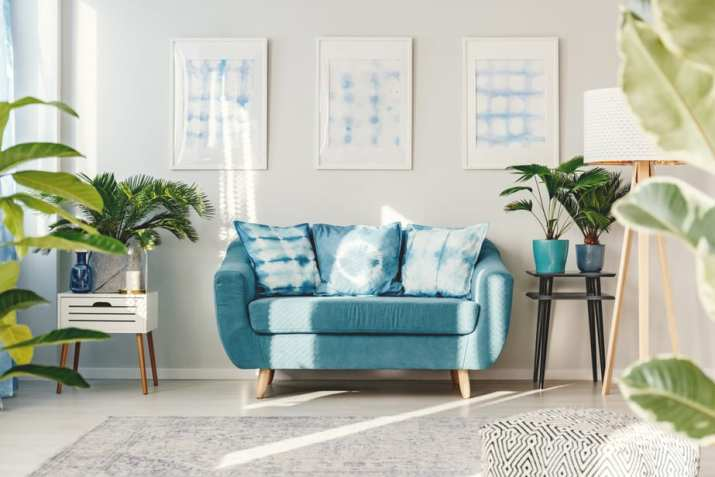 Bulky, Mini Blue Couch in A Living Space
