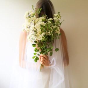 unrecognizable woman holding a bouquet