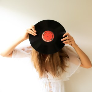 unrecognizable woman holding a record